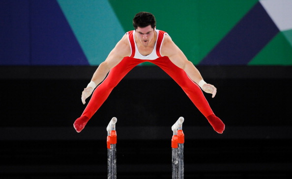 GLASGOW, SCOTLAND - AUGUST 01: Kevin Lytwyn of Canada on the parallel bars in the Gymnastics Artistic final during day 9 of the 20th Commonwealth Games at the Scottish Exhibition Centre on August 01, 2014 in Glasgow, Scotland. (Photo by Roger Sedres/Gallo Images/Getty Images)