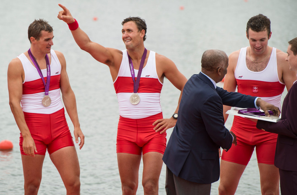 Canada's men's eight rowing team member Rob Gibson points to the stands during the podium ceremony at the 2012 London Olympics, on August 1, 2012. THE CANADIAN PRESS/HO, COC - Jason Ransom