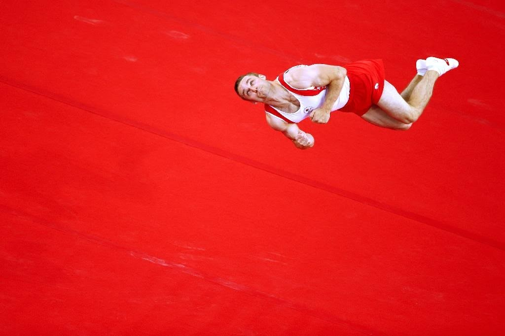 GLASGOW, SCOTLAND - JULY 31:  Silver medallist Scott Morgan of Canada competes in the Men's Floor Final during day eight of the Glasgow 2014 Commonwealth Games on July 31, 2014 in Glasgow, Scotland.  (Photo by Julian Finney/Getty Images)
