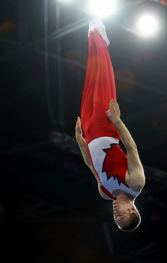 Jason Burnett of Canada competes in the men's qualification trampoline competition at the Beijing 2008 Olympic Games